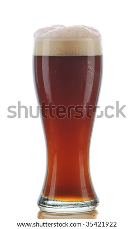 Glass of Dark Ale Beer with Foamy Head and Reflection isolated on white. Vertical Composition.