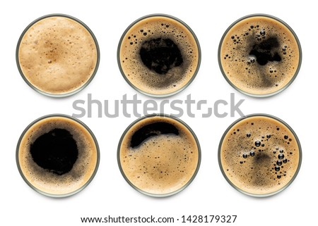Glass of dark stout beer with foam assortment top view collection isolated on white background. Stock photo ©