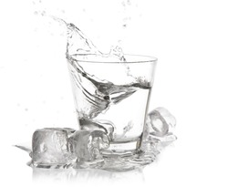 glass of drink with splash on white