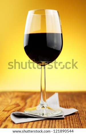 Glass of fine italian red wine on a old wooden table