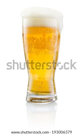 Glass of fresh beer with cap of foam isolated on white background