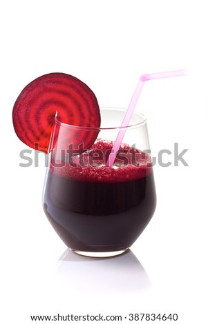 Glass of fresh beet juice with beet slice on it.Isolated on white background.