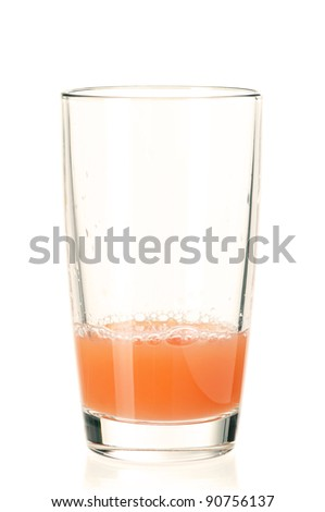 Glass of fresh grapefruit juice on white background