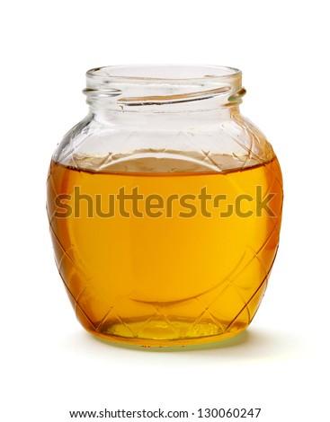 glass of fresh honey isolated on white background