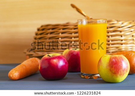 Glass of fresh  juice with fresh fruits and vegitables on wooden table, healthy food
