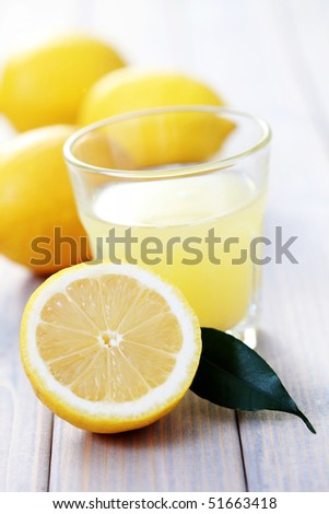 glass of fresh lemon juice with fresh fruits - food and drink