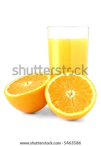 glass of fresh orange juice set against white with two halves of orange