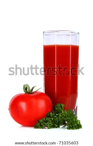 Glass of fresh tomato juice and tomatoes  round the glass  on the table
