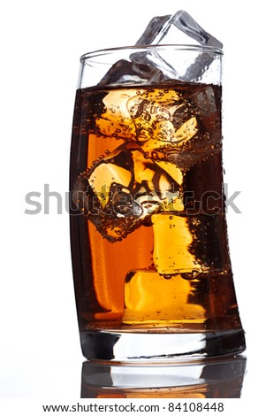 glass of freshly poured cola with ice