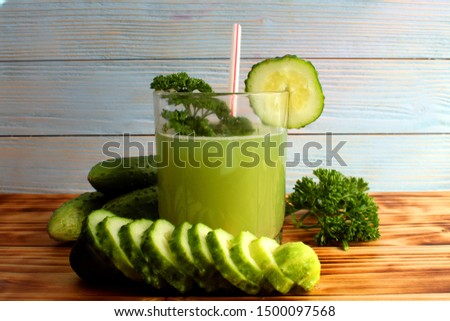 glass of freshly squeezed green cucumber juice
