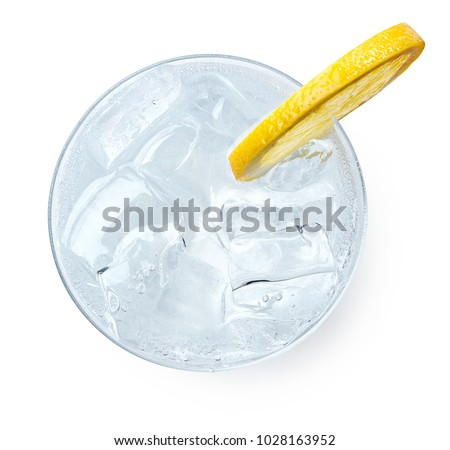 Glass of Gin and tonic with slice of lemon isolated on white background. Top view #1028163952