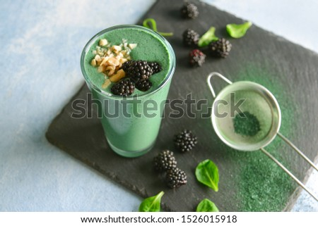Glass of healthy spirulina smoothie on table Foto stock ©