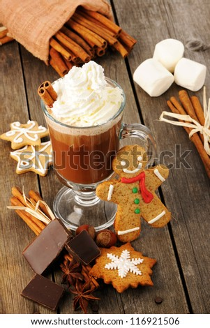 Glass of hot chocolate on wooden table
