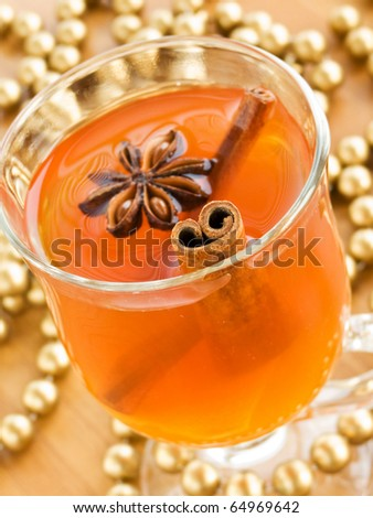 Glass of hot toddy with cinnamon and anise. Shallow dof.