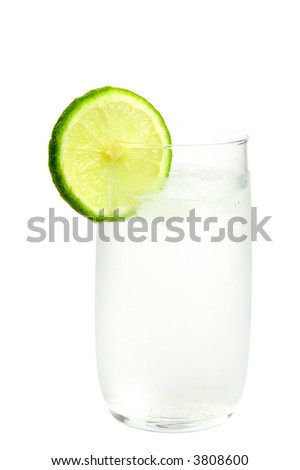 Glass of ice-cold water with slice of lime on white