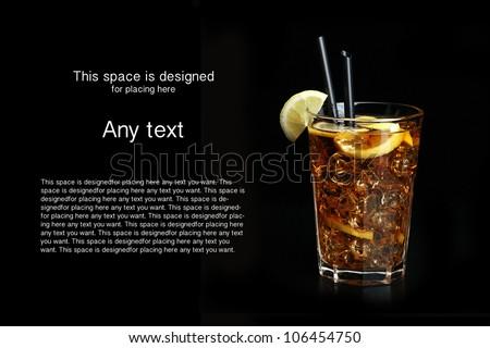 glass of ice tea with lemon on black background