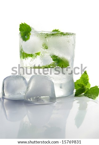 glass of ice water with fresh mint, on white - stock photo