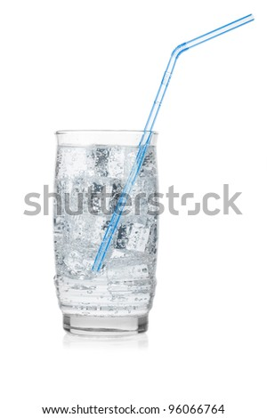 Glass of iced mineral water with straw isolated on white.