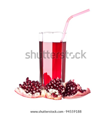 Glass of juice and ripe piece grenade on white background