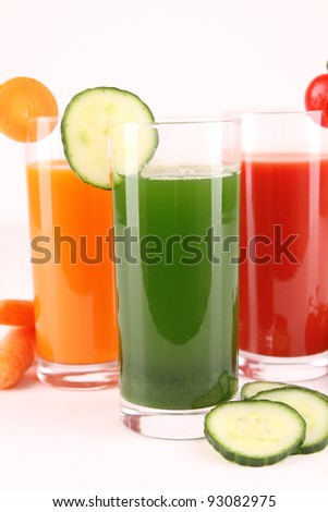 glass of juice on white