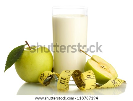 Glass of kefir, green apples and measuring tape isolated on white
