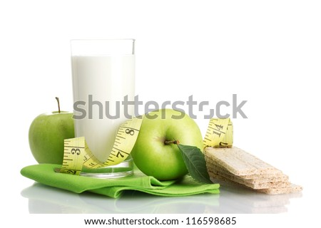 Glass of kefir, green apples, crispbreads and measuring tape isolated on white