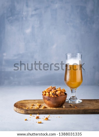 Glass of lager Beer and pretzel pieces snacks on light background with space for you text. #1388031335