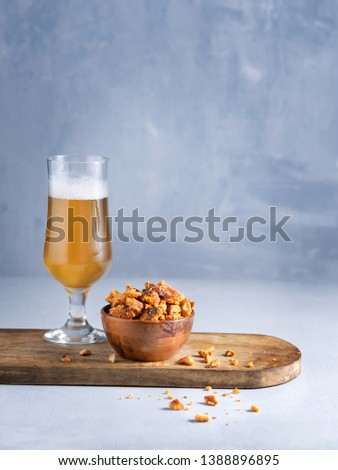 Glass of lager Beer and pretzel pieces snacks on light background with space for you text. #1388896895