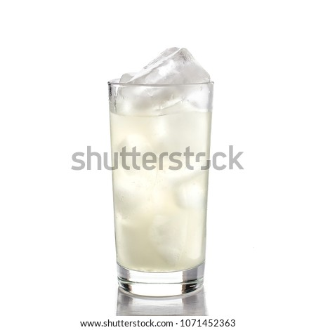 Glass of lemonade with ice on white background
