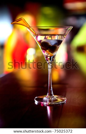 Glass of martini drink with olives at the bar ? cocktail concepts