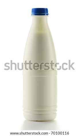 Glass of milk and bottle isolated on white