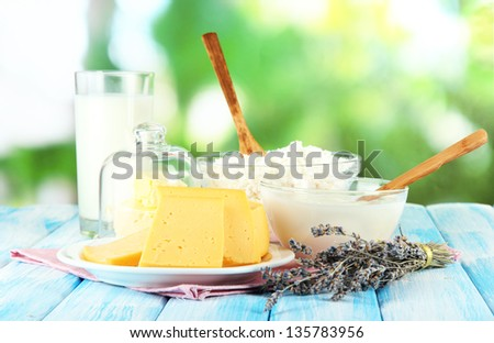 Glass of milk and cheese  on natural background