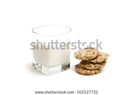 glass of milk and four cookies