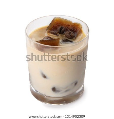 Glass of milk with coffee ice cubes on white background #1314902309