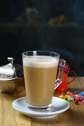 Glass of Milky coffee on table
