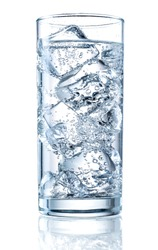 Glass of mineral carbonated water with ice