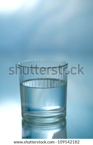 Glass of mineral water  on blue background