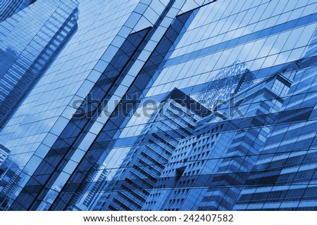 Glass of modern tower for business background #242407582