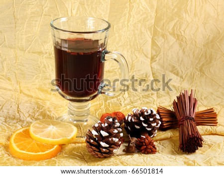 Glass of mulled wine, orange and spices