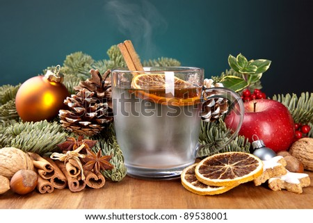 glass of mulled wine with cinnamon, lemon and anise