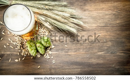 glass of natural beer. On a wooden table.