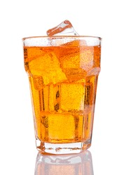Glass of orange energy soda drink with ice on white background