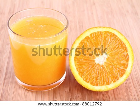 Glass of Orange juice and a half of an orange