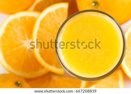 Shutterstock Glass of orange juice and fresh citrus fruit. Top view. Healthy food