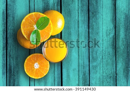 Glass of orange juice from above on vintage wood table. Empty ready for your orange juice, fruit product display or montage.