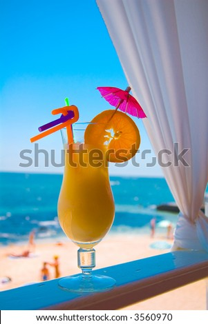 Glass of Pina Colada cocktail on the beach