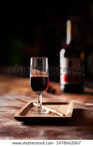 Glass of port wine on wooden table and over dark background, vertical orientation. Aperitif #1478662067