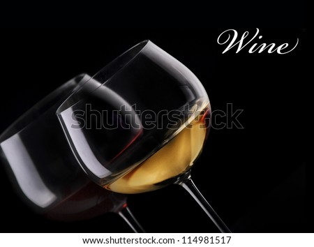 Glass of red and white wine on black background