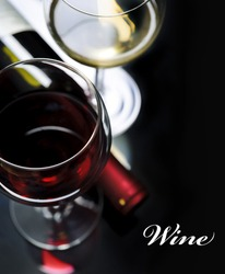 Glass of red and white wine on black background. Wine list design with copyspace.