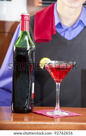 Glass of red color alcohol drink in the bar
